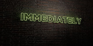 IMMEDIATELY -Realistic Neon Sign on Brick Wall background - 3D rendered royalty free stock image Stock Photos