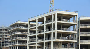 Immense building under construction with concrete walls Royalty Free Stock Photography