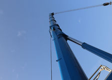 Immense hydraulic arm of a powerful crane for lifting heavy load Stock Images