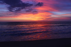 An Immensely Vivid Pacific Sunset. The beautiful end of a Pacific Sunset in Puerto Escondido, Mexico Stock Photography