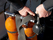 Before a immersing. Diver prepare a aqualung before a immersing Stock Photos