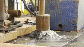 Immersing drilling pipe into the borehole stock video
