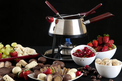 Immersion de chocolat fondue par fondue Photographie stock