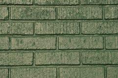 Immeuble de brique vert Photo stock