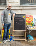 Immigrant at Anti UKIP stall in Thanet South. Immigrant posing at an Anti UKIP and Farage stall in Ramsgate, Thanet South during the General Election campaign in Royalty Free Stock Photo