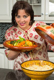 Immigrant lady in modern kitchen Royalty Free Stock Photography