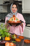 Immigrant lady with traditional dish Stock Photo