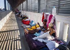 Immigrants at US Mexico border. Immigrants live on international bridge in Nuevo Progreso as they wait to be processed into the U.S. The Bridge  connects the royalty free stock photography