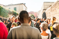 Immigrants march in rome asking for hospitality for refugees Rome, Italy, 11 September 2015. African migrant at protest marc in rome seen from behind stock images