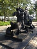 The Immigrants Monument in Battery Park. The Immigrants Monument in Battery Park, New York, NY Stock Image