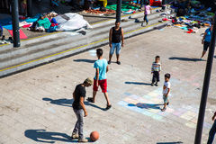 Immigrants playing football at the Keleti Trainstation in Budape Royalty Free Stock Photos