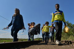 Immigrants. Syrians refugees walking on the tracks across the border, Serbia, Hungary Stock Image