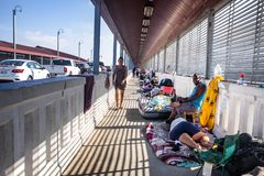 Immigrants at US Mexico border. Immigrants live on international bridge in Nuevo Progreso as they wait to be processed into the U.S. The Bridge  connects the stock photography