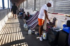 Immigrants at US Mexico border. Immigrants live on international bridge in Nuevo Progreso as they wait to be processed into the U.S. The Bridge  connects the stock photo