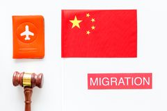 Immigration to China concept. Text innigration near passport cover and chinese flag, judge hammer on white background. Immigration concept. Text visa near royalty free stock image