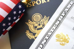 Immigration concept. US passport and flag over a citizenship and naturalization certificate royalty free stock image