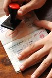 Immigration control. Mark by stamping a passeport royalty free stock image