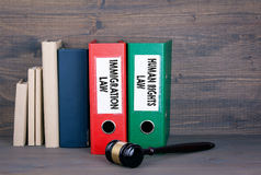 Immigration and Human Rights Law. Wooden gavel and books in background. Law and justice concept.  royalty free stock photos