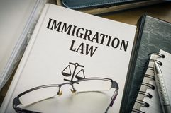 Immigration law book. Legislation and justice concept Royalty Free Stock Image