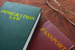 Immigration law. Book with words immigration law on a table stock photography