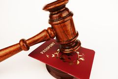 Immigration law concept with judge gavel and passport on an office table stock photos