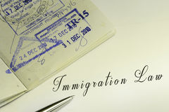 Immigration law. Document and arrival stamps on passport stock photo