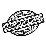 Immigration Policy rubber stamp. Grunge design with dust scratches. Effects can be easily removed for a clean, crisp look. Color is easily changed Stock Photos