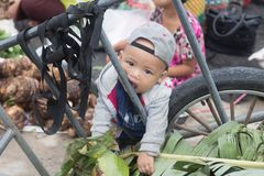 Immigration in Prachuap Khiri Khan Thailand - February, 03, 2018. Prachuap Khiri Khan Province,Thailand,-February,24,2018:Little boy looking at camera The mother Royalty Free Stock Photo