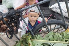 Immigration in Prachuap Khiri Khan Thailand - February, 03, 2018. Prachuap Khiri Khan Province,Thailand,-February,24,2018:Little boy looking at camera The mother Stock Images