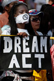 Immigration Protest at White House. WASHINGTON, DC - MAY 1: An immigration reform activist holds a sign reading Dream Act during a protest at the White House on stock images