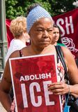 Woman Holds Abolish Ice sign at Immigration Rally. Immigration Rally held in Columbus Ohio on 06/30/18. Part of the nationwide rallies to protest Trump royalty free stock photos