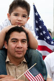 Immigration Rally in Washington. WASHINGTON, DC - MARCH 21: Daniel Rogel and his son Daniel Rogel Jr., age 4, stand with some 200,000 immigrants' rights stock photography