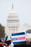 Immigration Rally in Washington. WASHINGTON, DC - MARCH 21: With the U.S. Capitol building in the distance, some 200,000 immigrants' rights activists flood the royalty free stock photos