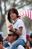Immigration Rally in Washington. WASHINGTON, DC - MARCH 21: A girl and her father stand with some 200,000 immigrants' rights activists flooding the National Mall stock photography