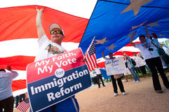 Immigration Rally in Washington. WASHINGTON, DC - MARCH 21: A giant American flag is carried among some 200,000 immigrants' rights activists flood the National stock photography