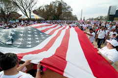 Immigration Rally in Washington. WASHINGTON, DC - MARCH 21: A giant American flag is carried among some 200,000 immigrants' rights activists flood the National royalty free stock images