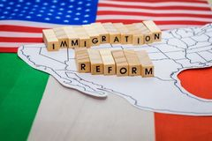 Immigration Reform concept with map on United States and Mexico Border with flags. Politics.  Issues.   Safety stock photo