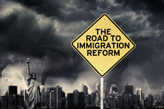 Immigration Reform word with signpost under storm. Picture of text of the road to immigration reform on a yellow signpost under dark cloud stock images
