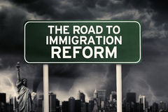 Immigration Reform word under storm cloud. Image of green signpost with text of the road to immigration reform under storm cloud stock images