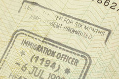 Immigration stamp. For UK macro view Stock Photos