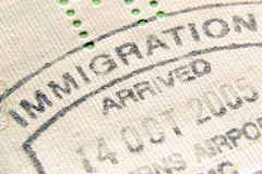 Immigration stamp. Immigration control passport stamp fragment; focus on Immigration word royalty free stock images