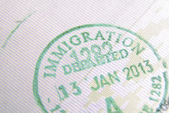 Immigration stamp. Immigration control passport stamp fragment; focus on Immigration word stock image