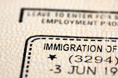 Immigration stamp in passport. Royalty Free Stock Photo