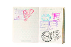 Immigration stamps in Canadian Passport. Multiple entries into South East Asia and Australia, resulting in entry and exit stamps in a Canadian passport. Isolated Royalty Free Stock Photography