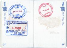 Immigration stamps of India in a French passport Royalty Free Stock Photography
