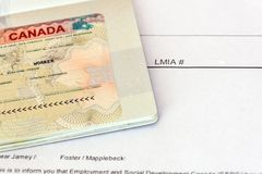 Canadian working visa and LMIA, Labour Market Impact Assessment paper document. stock photography