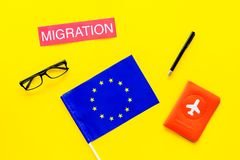 Schengen visa. Immigration to Europe concept. Text immigration near passport cover and european flag on yellow. Immigration to Europe concept. Text immigration stock photos