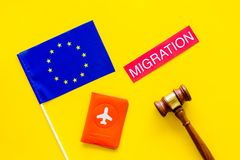Schengen visa. Immigration to Europe concept. Text immigration near passport cover and european flag, hammer on yellow. Immigration to Europe concept. Text royalty free stock photos