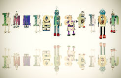 Immigration. The Word immigration with retro robot toys royalty free stock photos
