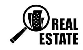 Immobilienikone mit Vergrößerungsglaslinse Lizenzfreies Stockfoto
